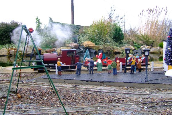Santa special leaving station area waving crowd.jpg